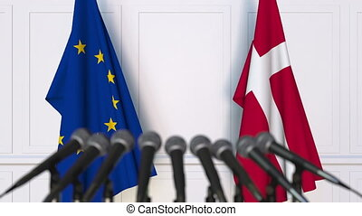 Flags of the European Union and Denmark at international meeting or negotiations press conference