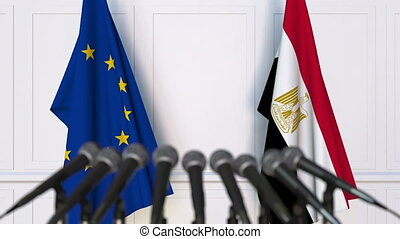Flags of the European Union and Egypt at international meeting or negotiations press conference