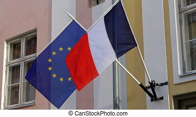 Flags of the European Union and France.