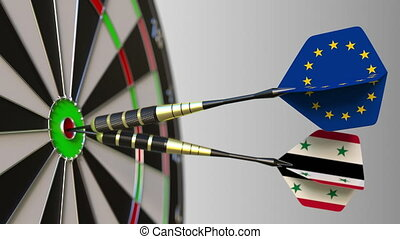 Flags of the European Union and Syria on darts hitting...