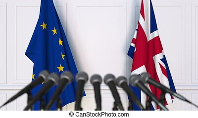 Flags of the European Union and The United Kingdom at international meeting or negotiations press conference