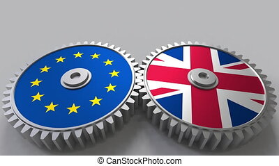 Flags of the European Union and The United Kingdom on meshing gears. International cooperation conceptual animation