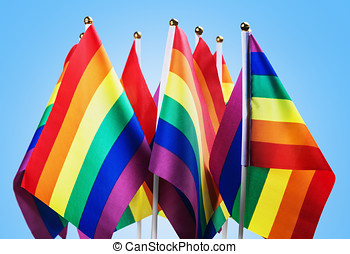 flags of the LGBT community on a blue