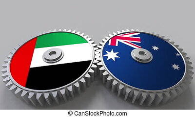 Flags of the UAE and Australia on meshing gears....
