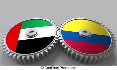 Flags of the UAE and Colombia on meshing gears....