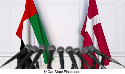 Flags of the UAE and Denmark at international meeting or...