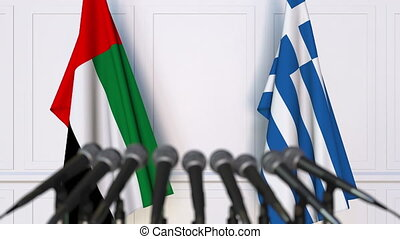 Flags of the UAE and Greece at international meeting or...