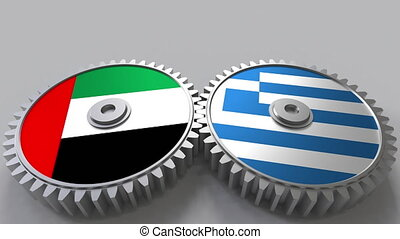 Flags of the UAE and Greece on meshing gears. International...