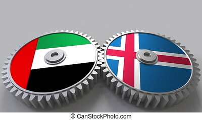 Flags of the UAE and Iceland on meshing gears. International...