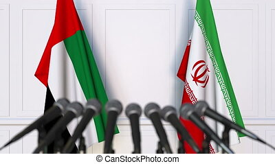 Flags of the UAE and Iran at international meeting or...