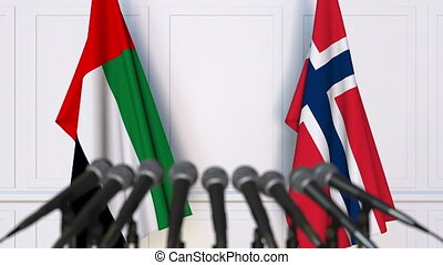 Flags of the UAE and Norway at international meeting or...