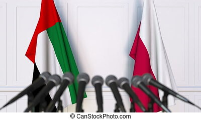 Flags of the UAE and Poland at international meeting or...