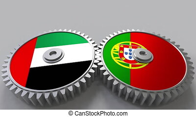 Flags of the UAE and Portugal on meshing gears....