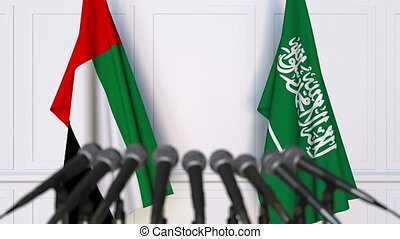 Flags of the UAE and Saudi Arabia at international meeting...