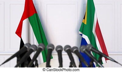 Flags of the UAE and South Africa at international meeting...