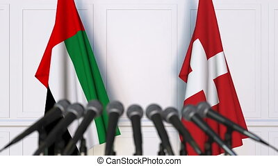 Flags of the UAE and Switzerland at international meeting or...