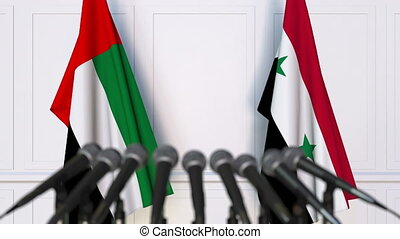 Flags of the UAE and Syria at international meeting or...
