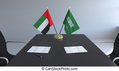 Flags of the United Arab Emirates and Saudi Arabia and...
