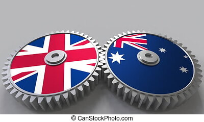 Flags of the United Kingdom and Australia on meshing gears....
