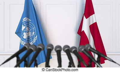 Flags of the United Nations and Denmark at international...