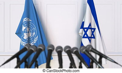Flags of the United Nations and Israel at international...