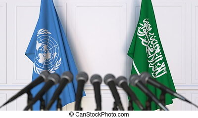 Flags of the United Nations and Saudi Arabia at...