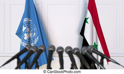 Flags of the United Nations and Syria at international...