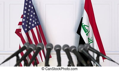 Flags of the United States and Iraq at international meeting...