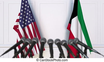 Flags of the United States and Kuwait at international...