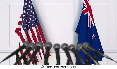 Flags of the United States and New Zealand at international...