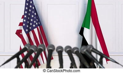 Flags of the United States and Sudan at international...