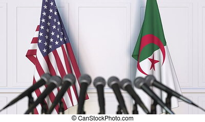 Flags of the USA and Algeria at international meeting or...