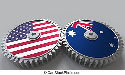 Flags of the USA and Australia on meshing gears. International cooperation conceptual 3D rendering