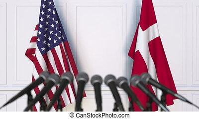 Flags of the USA and Denmark at international meeting or...