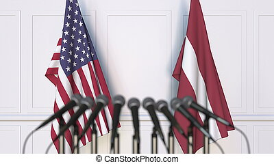 Flags of the USA and Latvia at international meeting or conference. 3D rendering