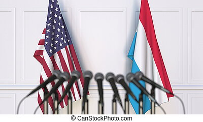 Flags of the USA and Luxembourg at international meeting or ...