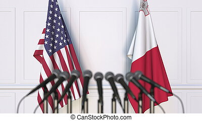 Flags of the USA and Malta at international meeting or conference. 3D rendering
