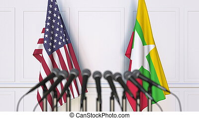 Flags of the USA and Myanmar at international meeting or conference. 3D rendering