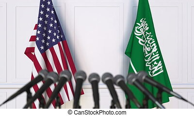 Flags of the USA and Saudi Arabia at international meeting...