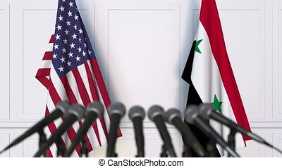 Flags of the USA and Syria at international meeting or...