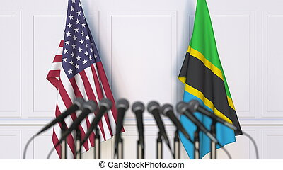 Flags of the USA and Tanzania at international meeting or conference. 3D rendering