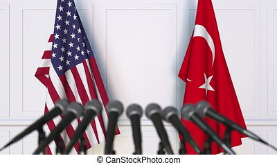 Flags of the USA and Turkey at international meeting or...