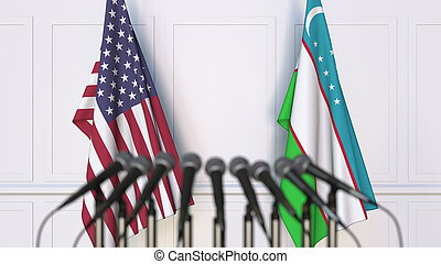 Flags of the USA and Uzbekistan at international meeting or conference. 3D rendering