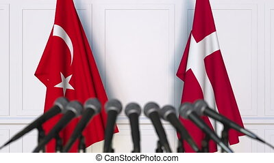 Flags of Turkey and Denmark at international meeting or...