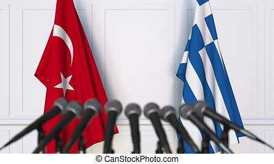Flags of Turkey and Greece at international meeting or...