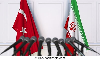 Flags of Turkey and Iran at international meeting or...