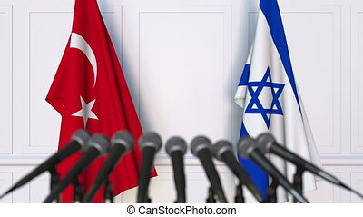 Flags of Turkey and Israel at international meeting or...