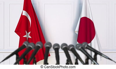Flags of Turkey and Japan at international meeting or...