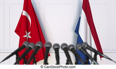 Flags of Turkey and Netherlands at international meeting or...