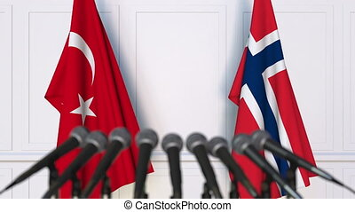 Flags of Turkey and Norway at international meeting or...